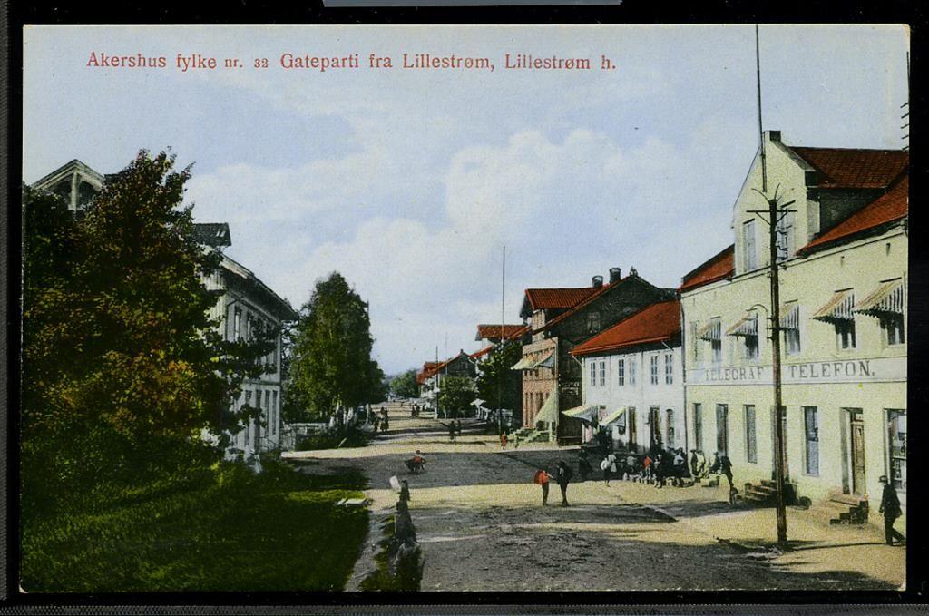 Akershus LILLESTRØM. Tidlig 1900-tallet, koloret gateparti. Nr. 32 i serien fra Ak. krets av Norges Lærerlag i samarb. m/Mittet