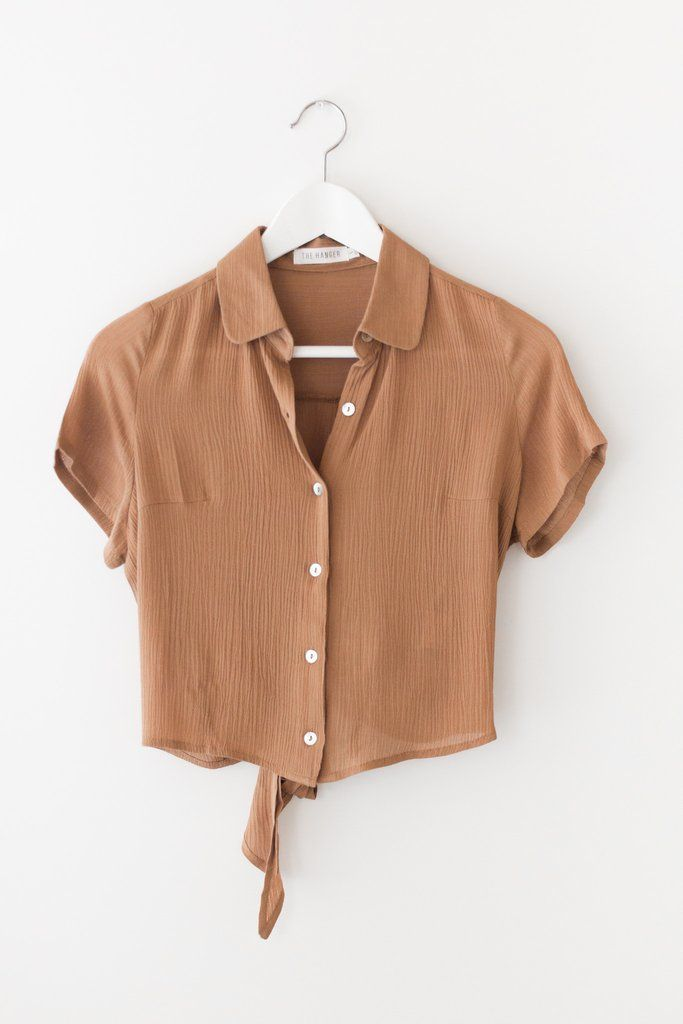 90ea2ed3 Collared button down crop top with bow-tie detailing in back. Made with  lightweight, loose, and flowy woven material. Available in Cognac, Rust and  Olive ...