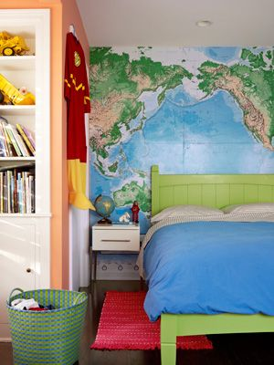 Love the world map covering the whole wall behind the bed