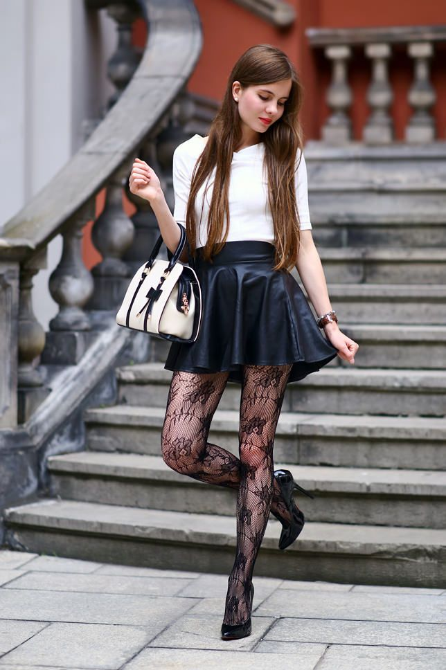 Elegant white blouse, leather skirt and lacy tights