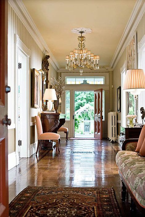 The grand scale feels right at home in this entryway it for Traditional foyer decorating ideas