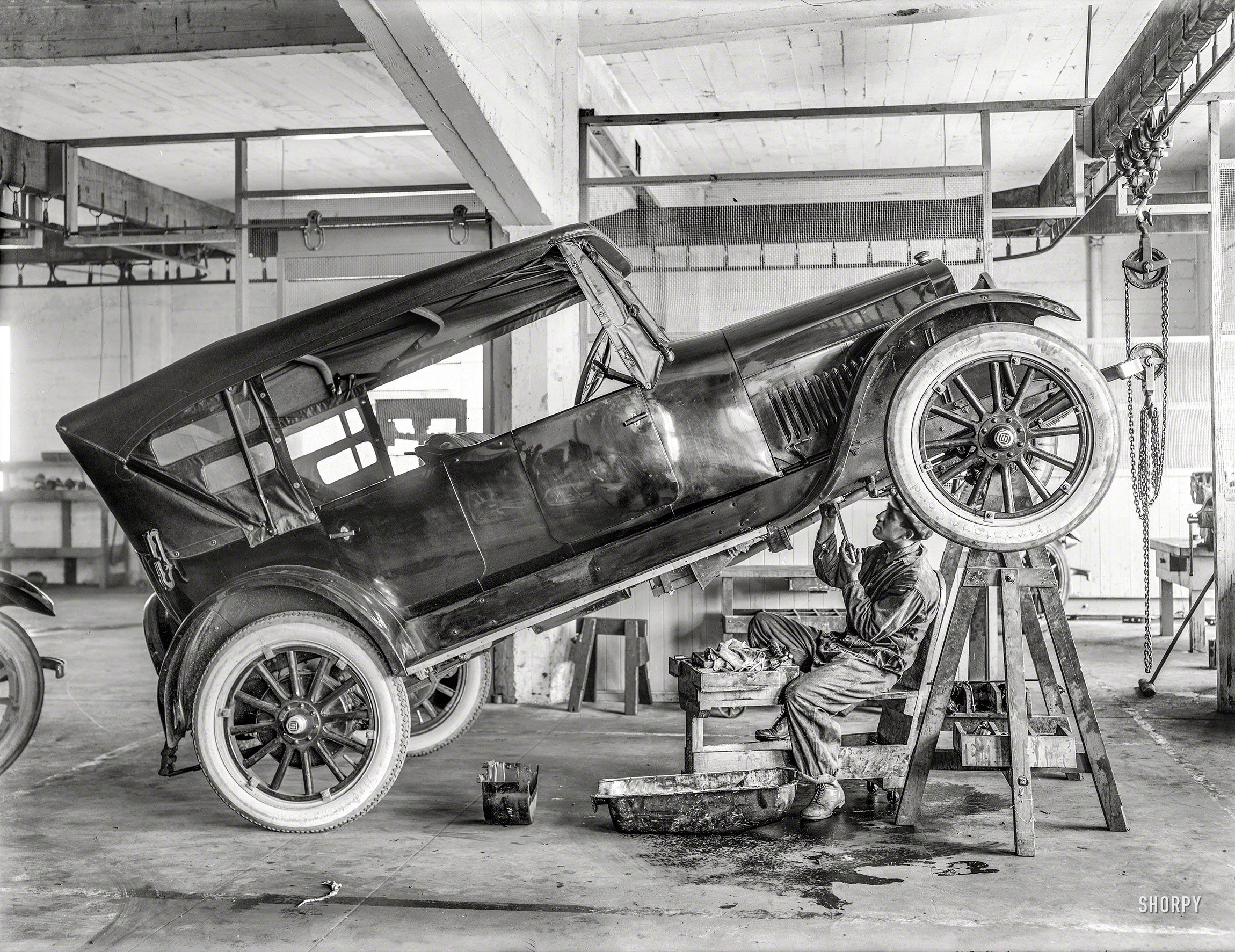 Circa 1919 Studebaker Motor Car In Repair Shop With