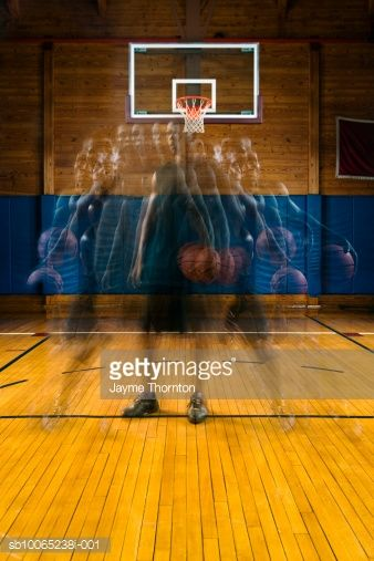 Stock Photo : Man holding basketball standing on court, multiplicated image, digital composite