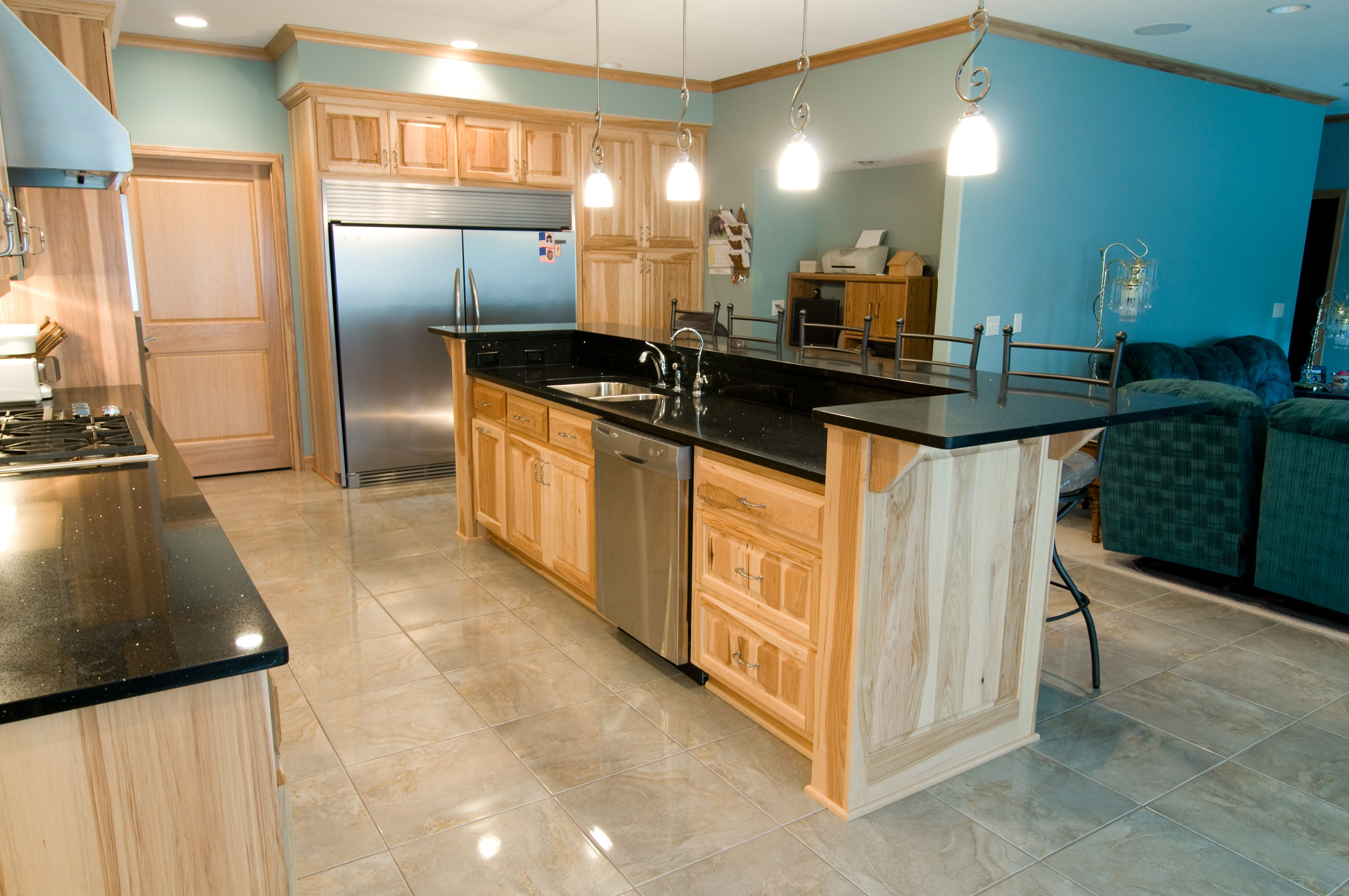 Best Hickory Cabinets Black Stone Countertops And A Light 400 x 300