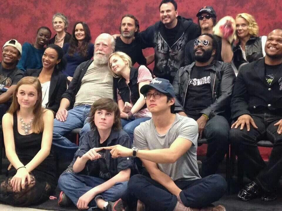 i love this but i have no idea why Steven Yeyn and Chandler Riggs at finger high fiving....