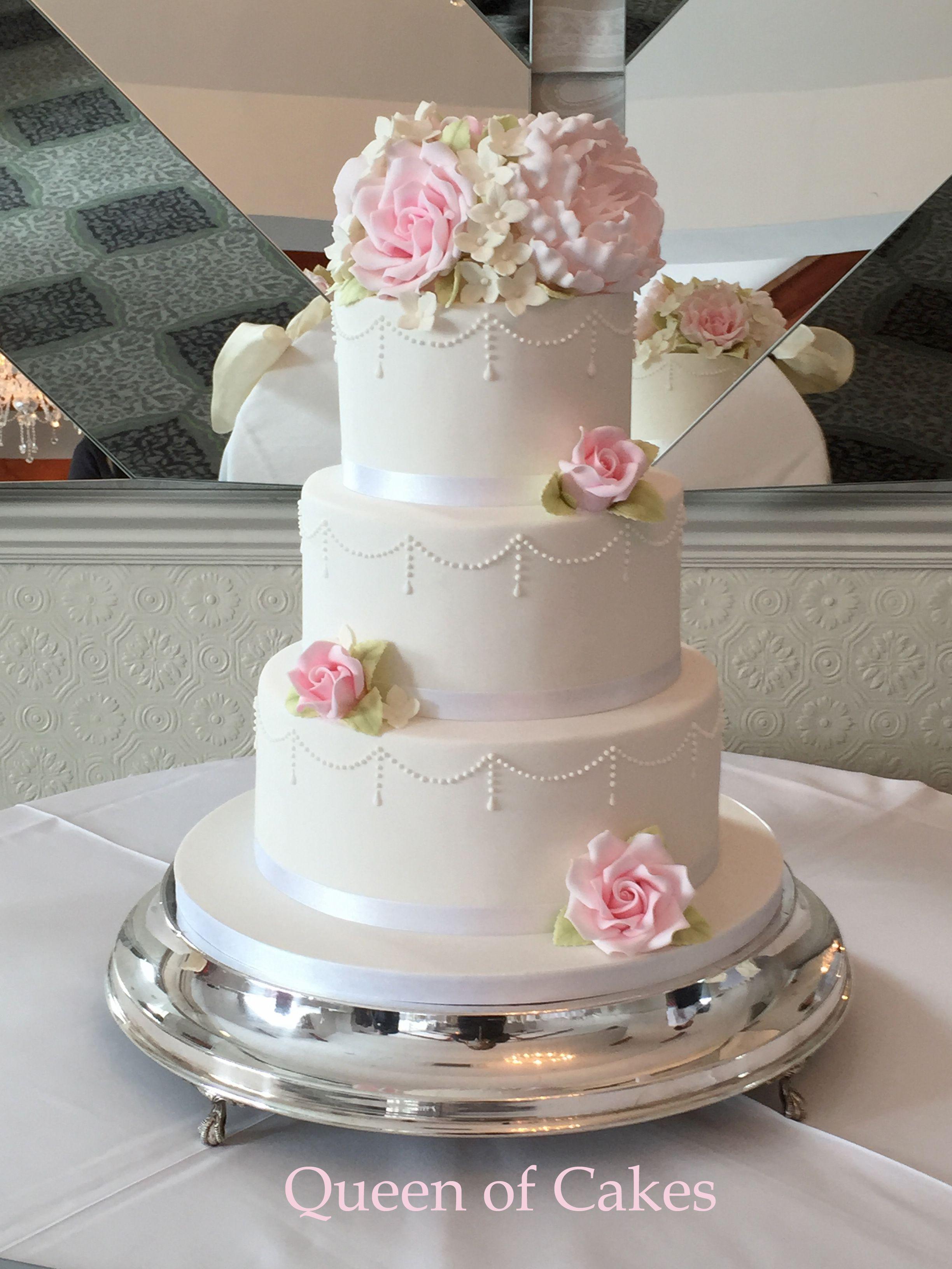 Spring bloom wedding cake by queen of cakes sugar peonies roses
