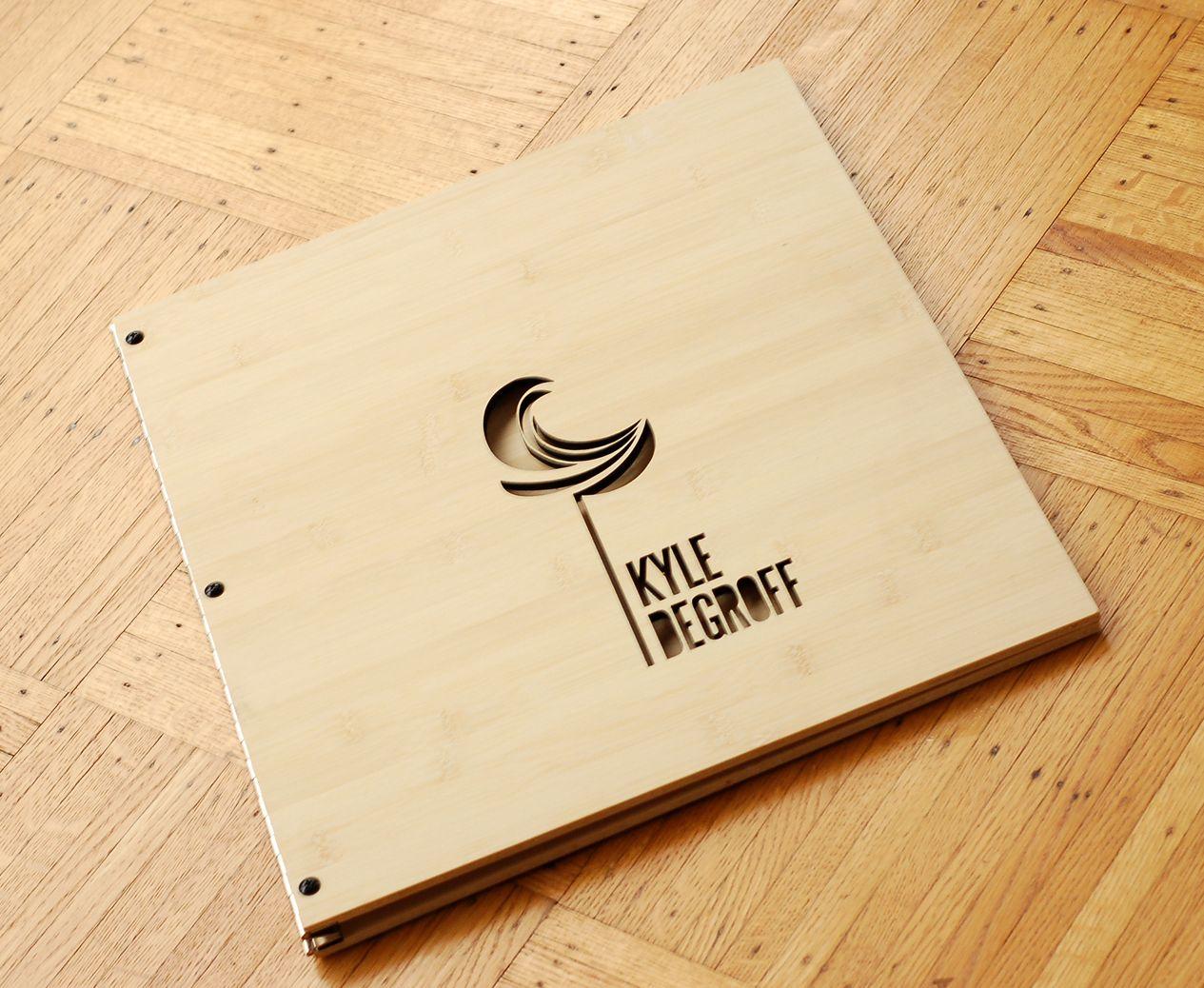 custom graphic designer portfolio book in bamboo with logo