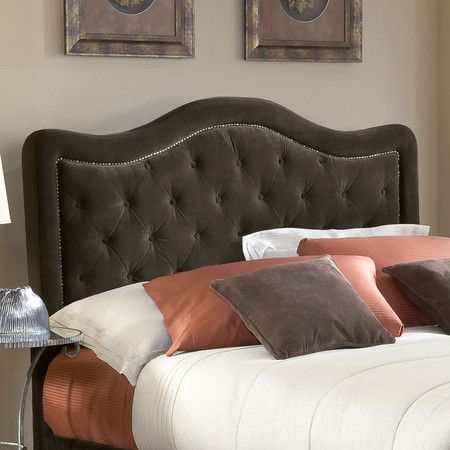 Tufted velveteen headboard in chocolate with nailhead trim and wood frame.  Product: HeadboardConstruction Material:...