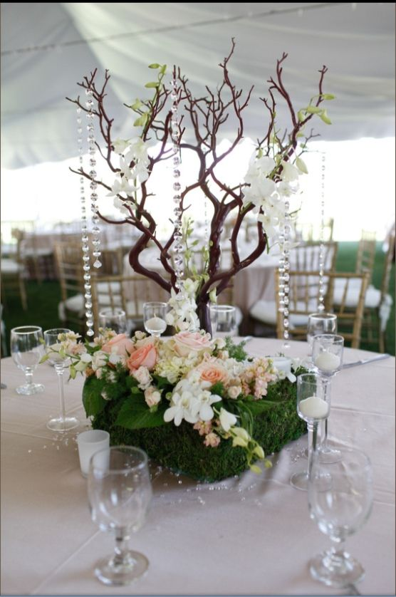 Manzanita tree wedding centerpiece with moss orchids