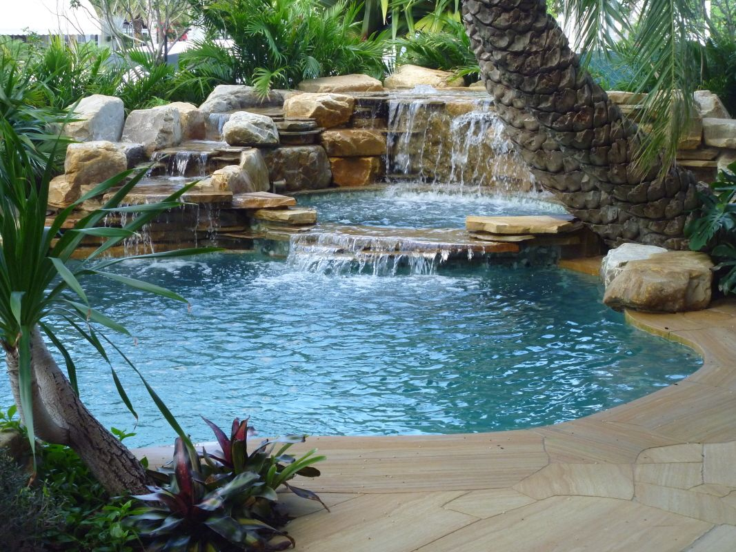 Pools with waterfalls waterfalls into pool jacuzzi for Garden waterfall design