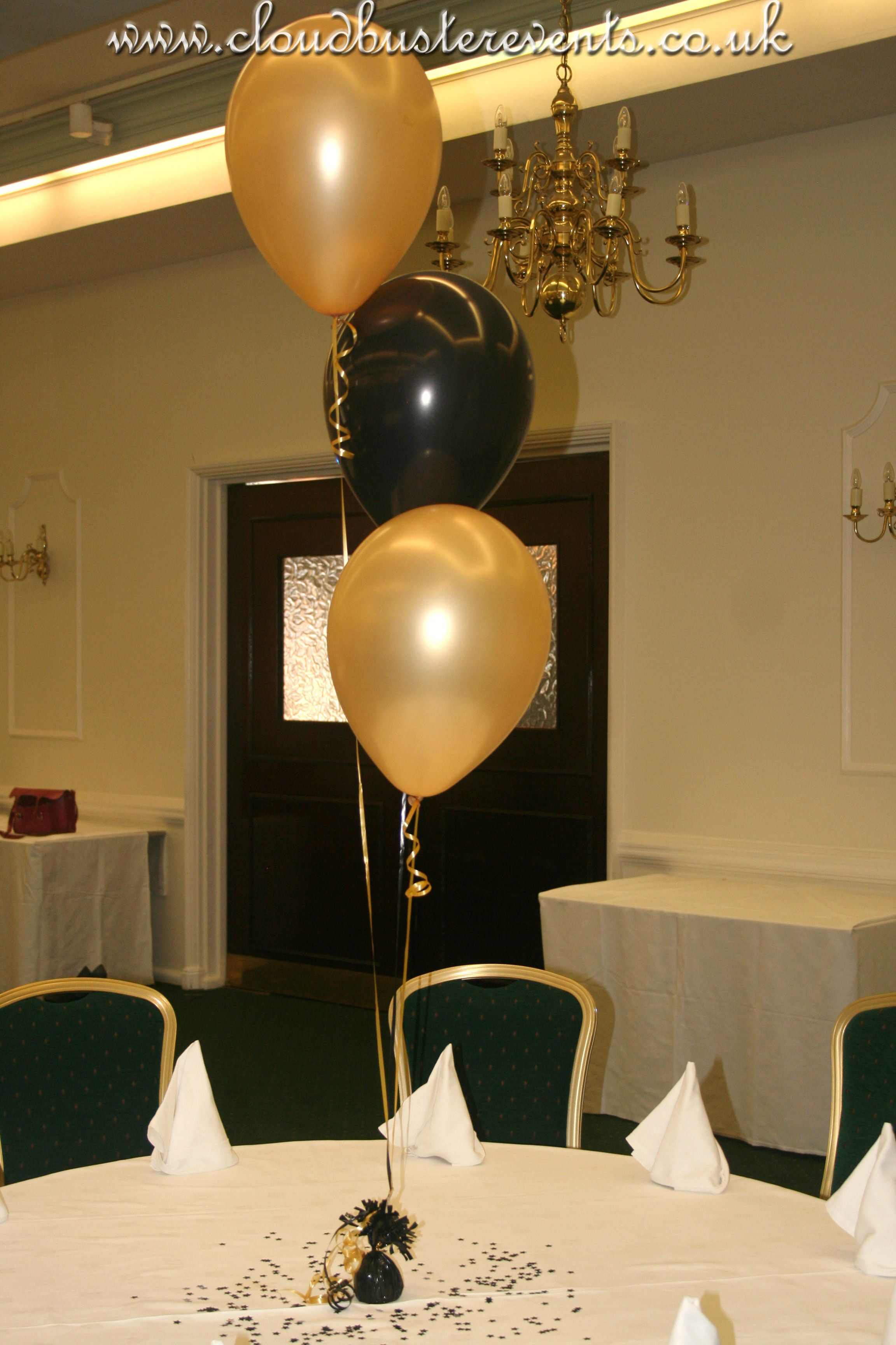 Gold and black balloon table bouquet favorite things
