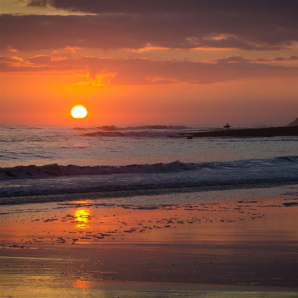 Surfing on a Sunset iPad Air wallpaper Beach sunset