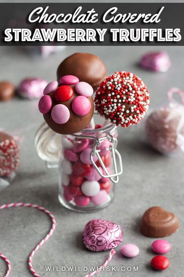These adorable Chocolate Covered Strawberry Truffles Pops are the perfect Valentine's Day desserts and edible gifts. The truffle center is made with freeze dried strawberry which creates a delicious strawberry flavor explosion. #wildwildwhisk #ad #chocolate #chocolatetruffles #chocolaterecipes #strawberry #truffles #trufflesrecipes #valentines #valentinesday #chocolatecoveredstrawberries #freezedriedstrawberries These adorable Chocolate Covered Strawberry Truffles Pops are the perfect Valentine' #freezedriedstrawberries