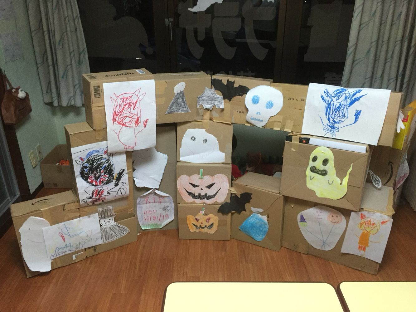 Haunted House for Halloween. Boxes tapes together, kids decorated with their own pictures.
