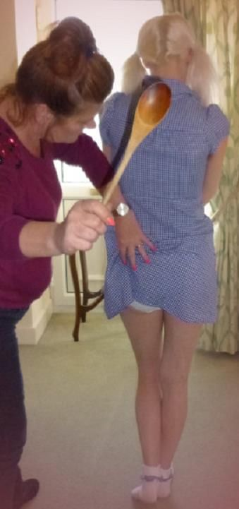 Spanking with wooden spoon — photo 10