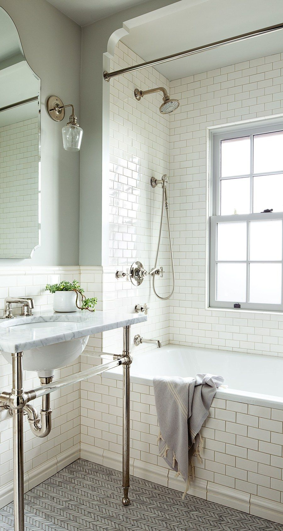 As in the master bath and powder room, the washstand in the ...