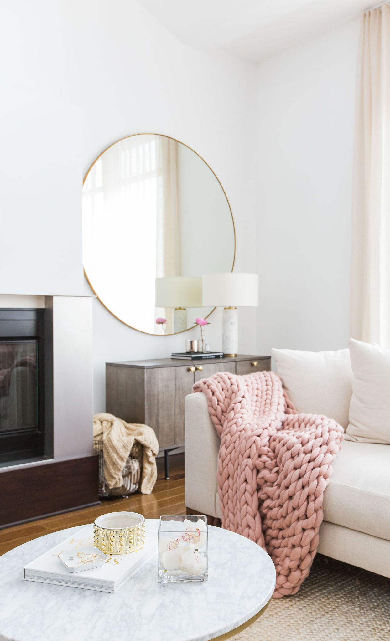 Marble coffee table with neutral couch in Marianna Hewitt's home