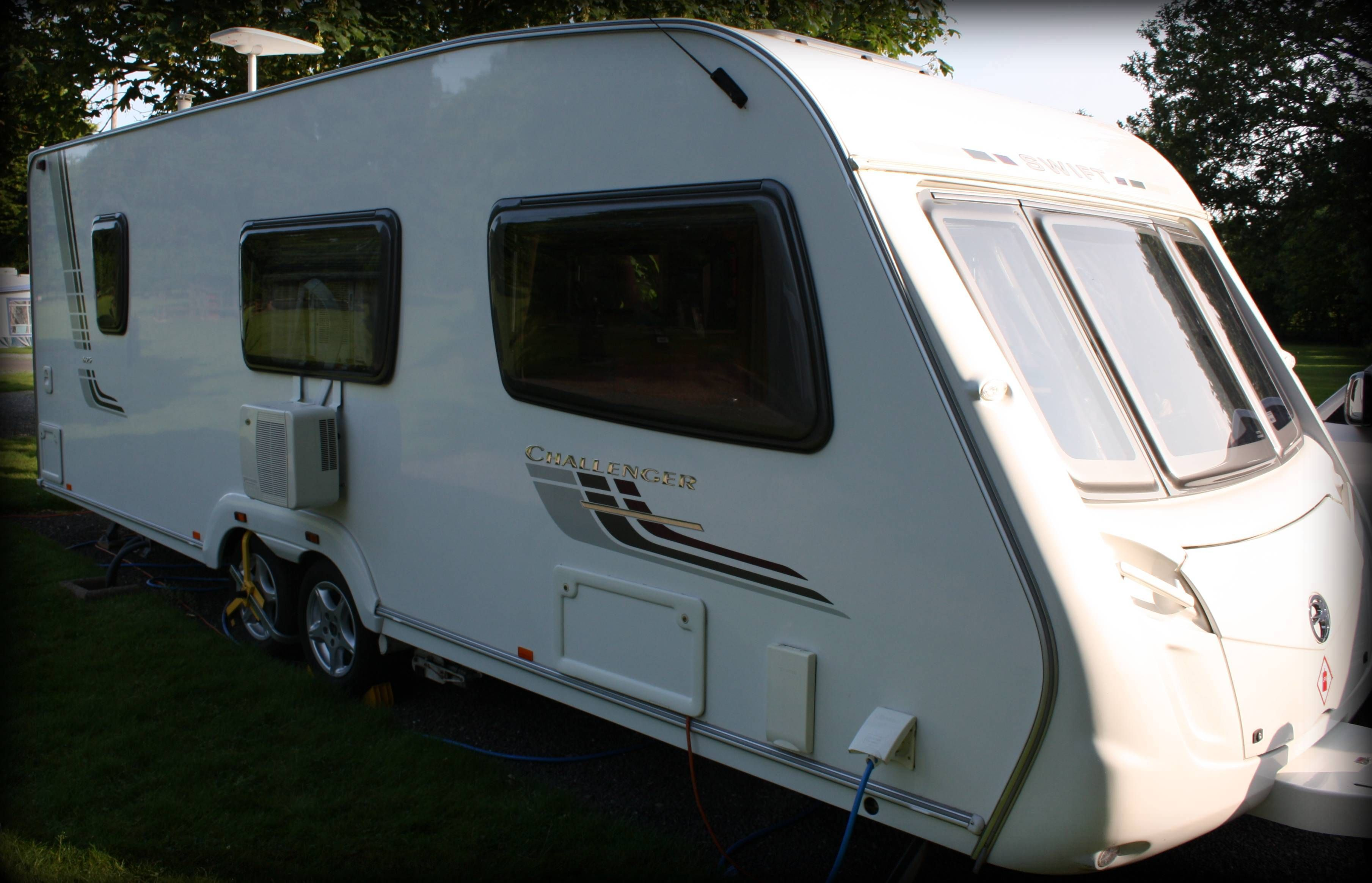 Portable air conditioning unit shown on a Swift Challenger caravan