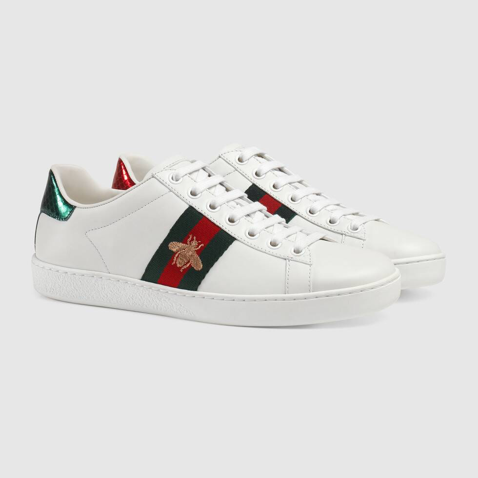 Shop The Women S Ace Embroidered Sneaker In White Leather At Gucci Com Enjoy Free Shipping And Complimentary Gift Gucci Ace Sneakers Sneakers Womens Sneakers