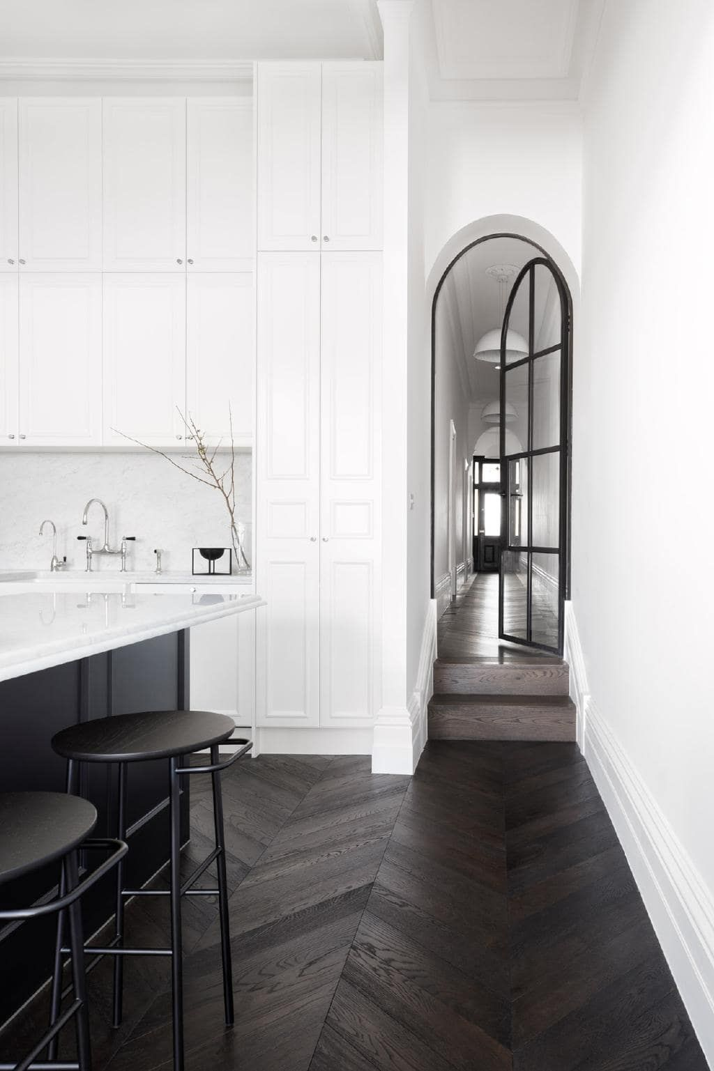 This renovated Melbourne terrace features a striking monochrome ...