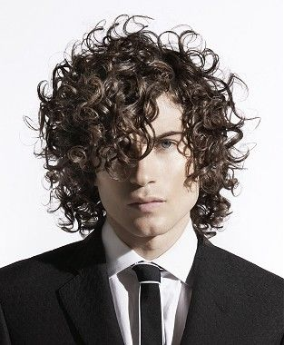 A long brown curly messy curl Mens hairstyle by Peter Prosser