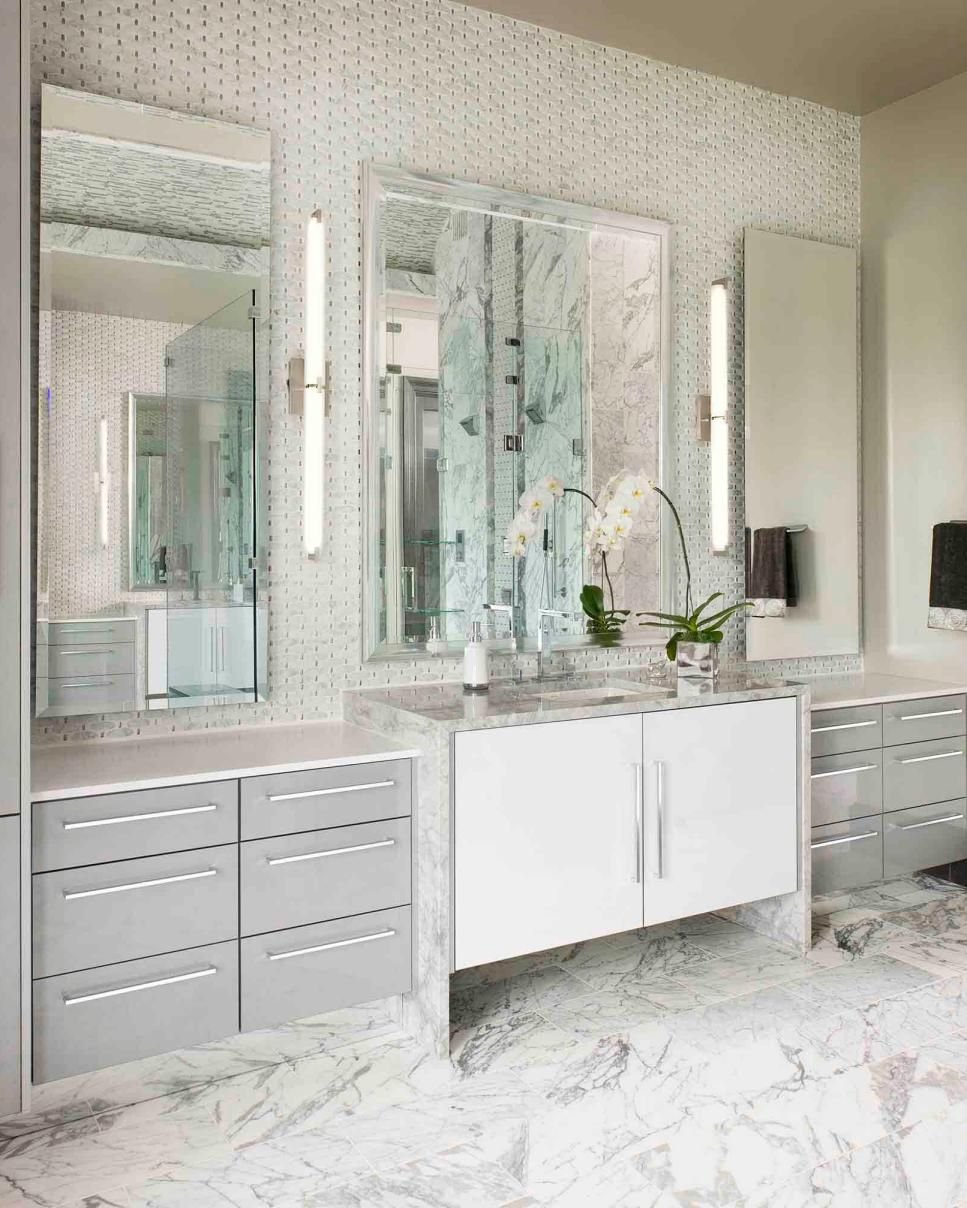 This Light And Bright Bathroom Features A White And Gray