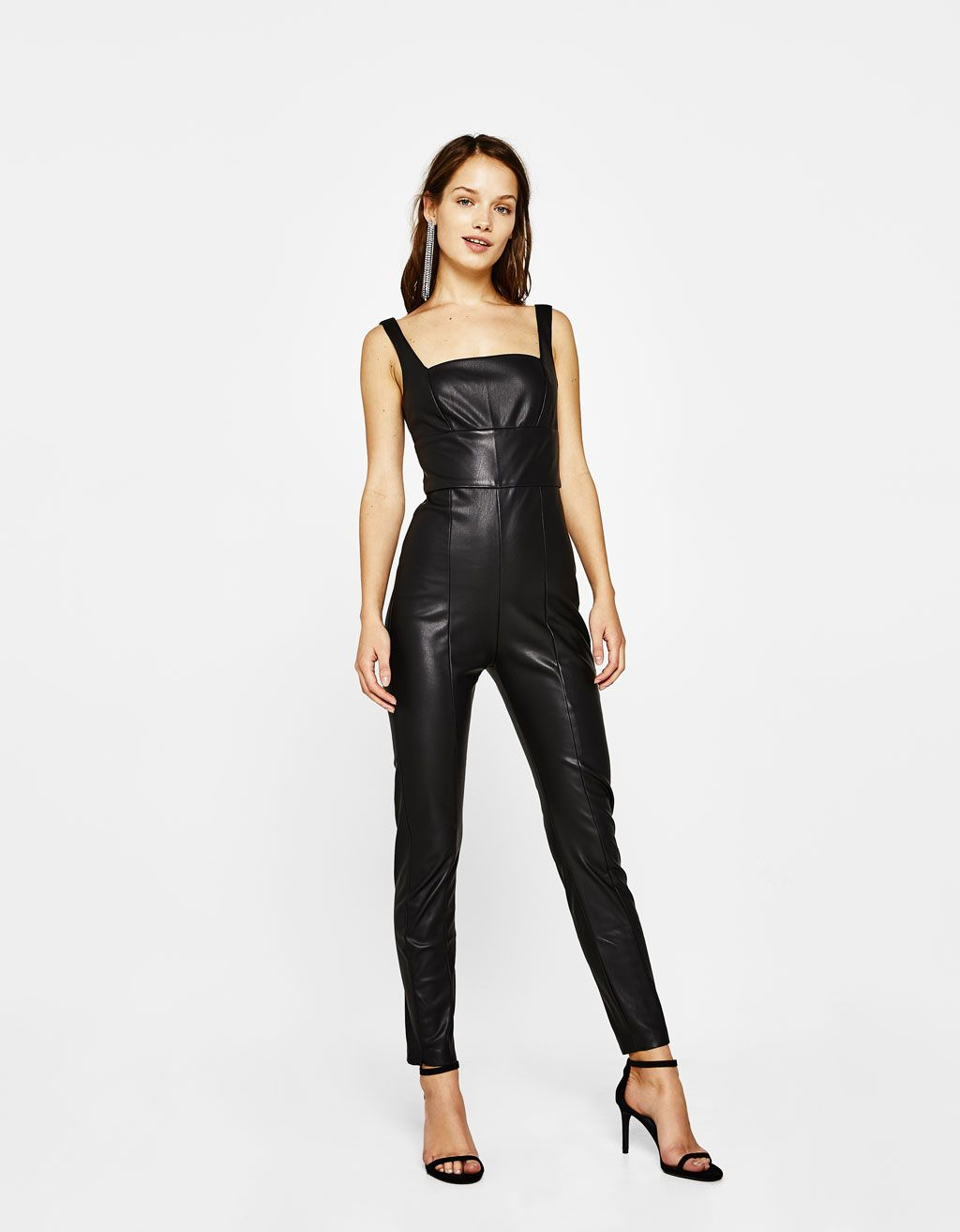 4350d944fe Long faux leather jumpsuit. Discover this and many more items in Bershka  with new products every week