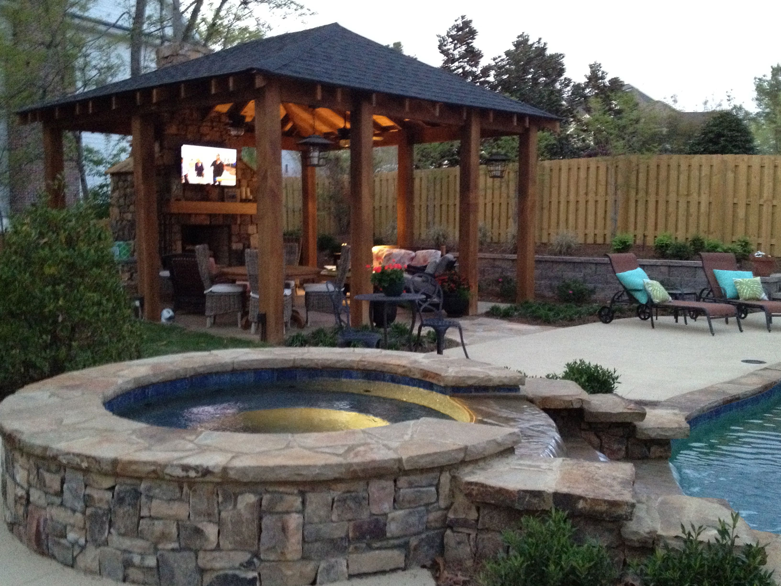 Outdoor space...fun hot tub, love the tv space under the ...