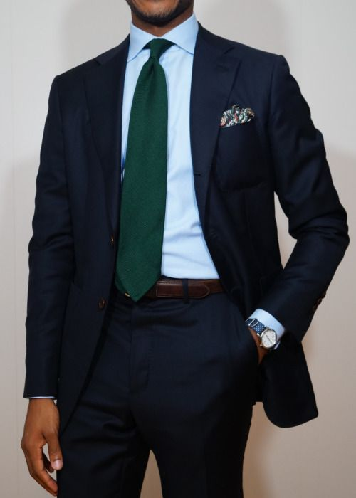Navy suit, light blue shirt, green tie