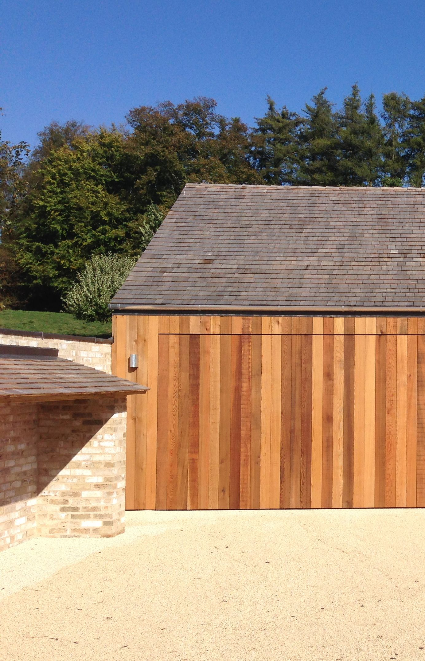 Mclean Quinlan The Stables Cedar Cladding With Shingle Roof Brickwork Wood Store Concealed Garage Door Hot Tub House Cedar Cladding Cladding