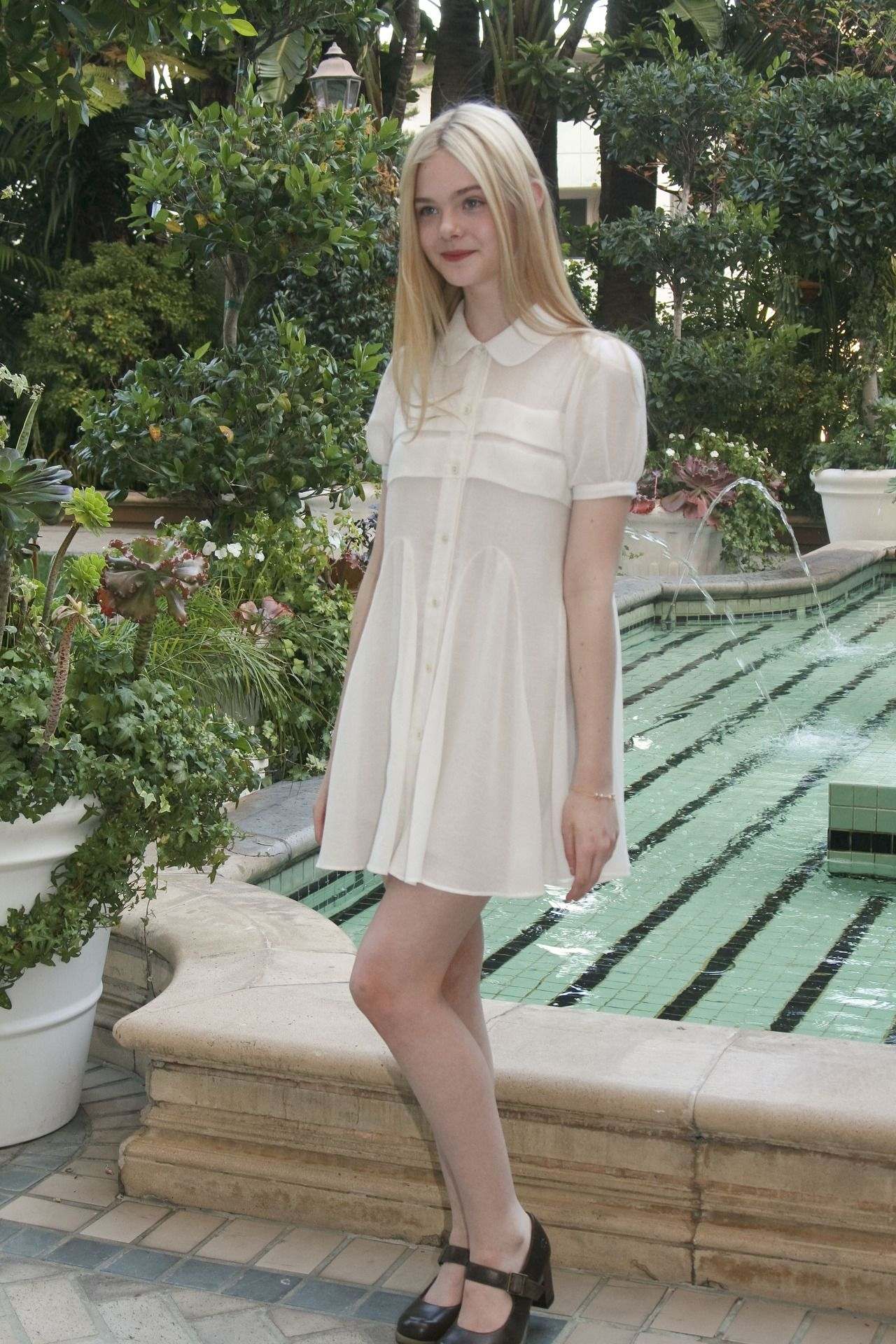 Elle fanning at a press conference for somewhere august th