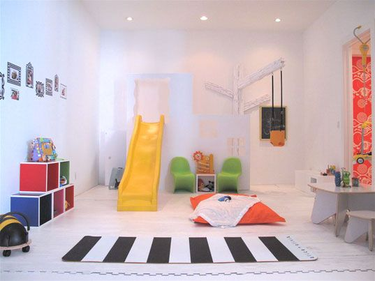 This looks like a super fun kids room. Who wouldn\'t want a slide ...