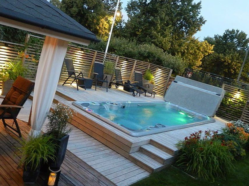 Hydropool 19fx swim spa in multi tiered decking pool for Swimming pool spa designs