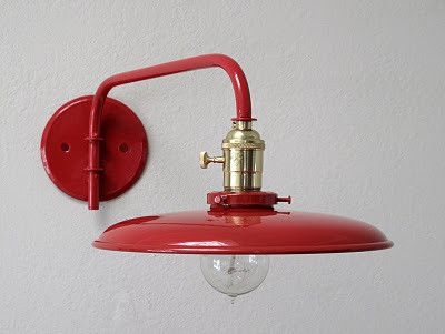 Wall-mounted red swing arm lamp