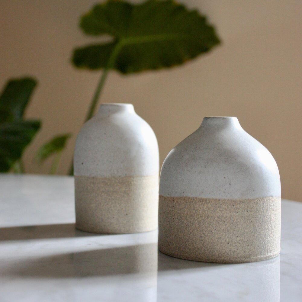Simple and beautiful small vases from the small pottery studio of ceramicist Tomoko Morisaki. She draws inspiration from found objects in nature and aims to create simple, warm pieces to be used daily. All of her work is thrown on a wheel. The glaze on these vases have a delicate speckling reminiscent of a fragile bird egg. Tomoro PotteryWheel thrown in Los Angeles, CA Due to their handmade nature, each vase is unique and will have small variations in color and size from the vases in these image