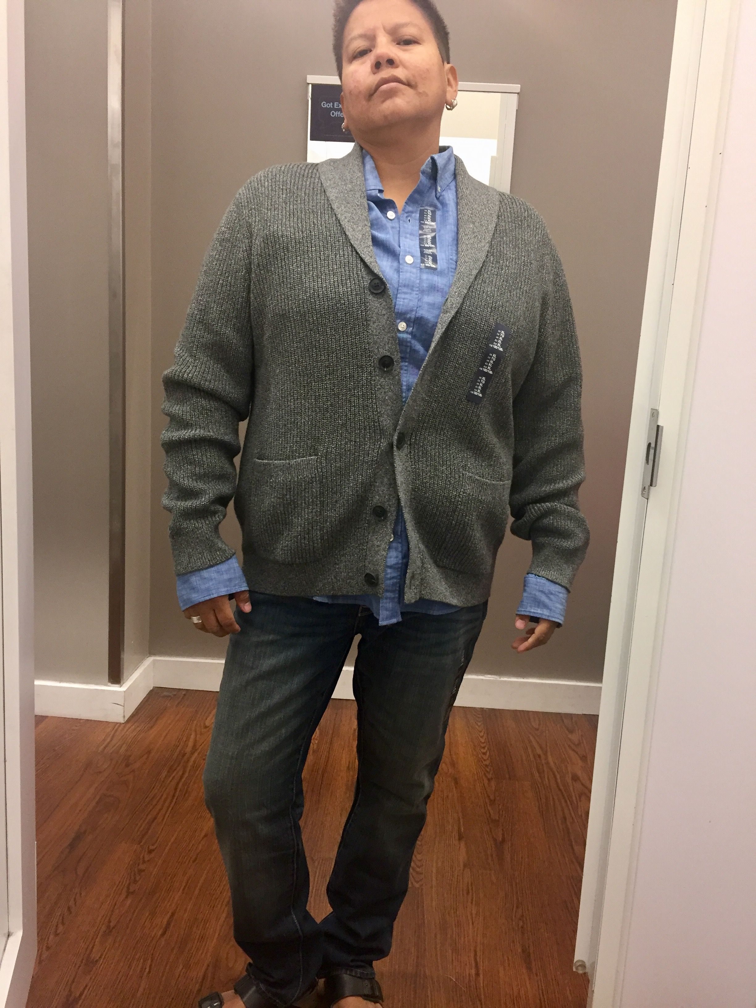 Dark blue fitted jeans, paisley white shirt under a grey cardigan ...
