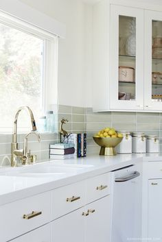 The Faucet Might Work Exclusive Tour Claire Thomas Mod House On Stilts Via White Kitchen With Brass Hardware And Fittings