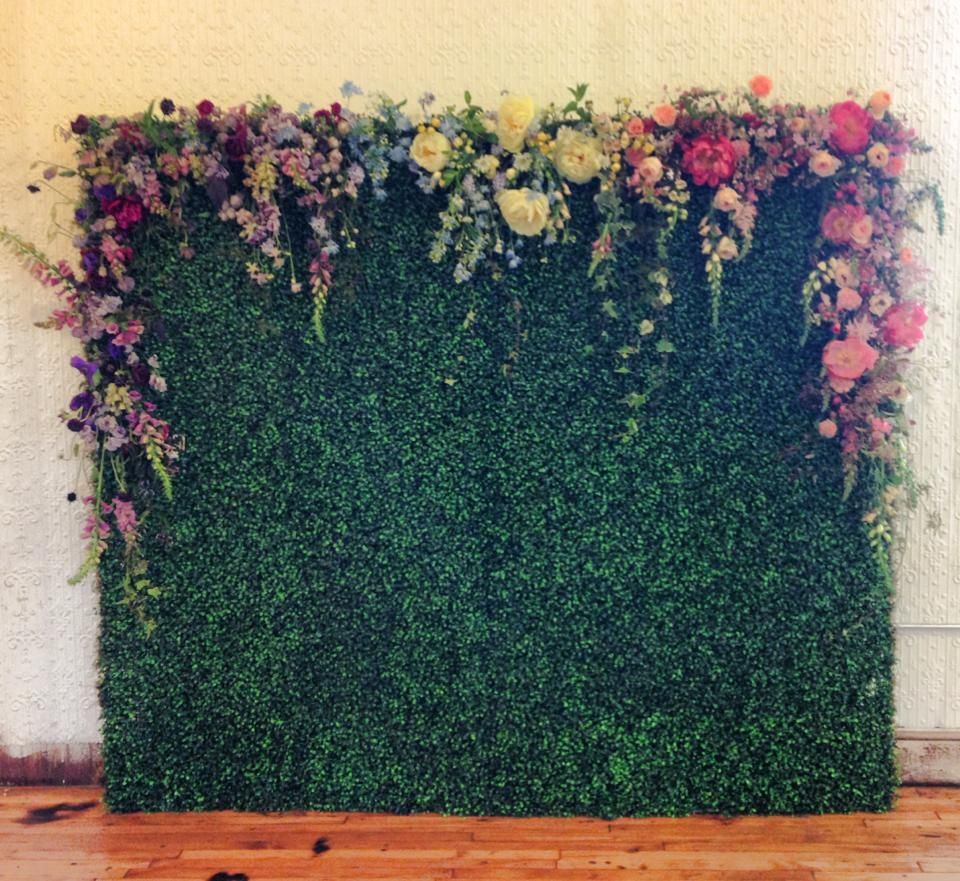 Floral draped boxwood wall by Sullivan Owen Floral and Event Design Philadelphia