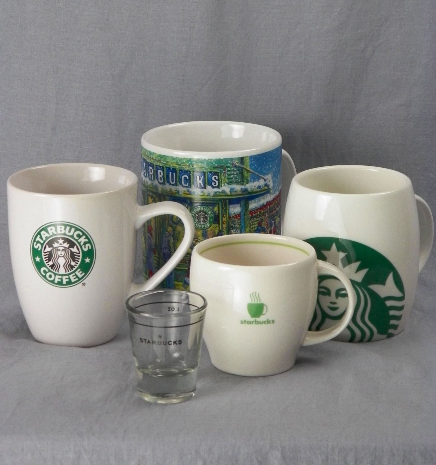 Handsome set of FIVE Starbucks coffee mugs. An instant