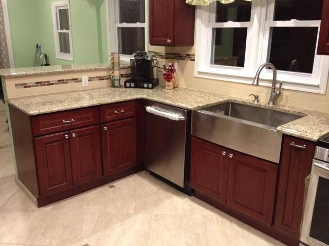 cherry kitchen cabinets stainless steel farm sink beige granite counter tops subway tile
