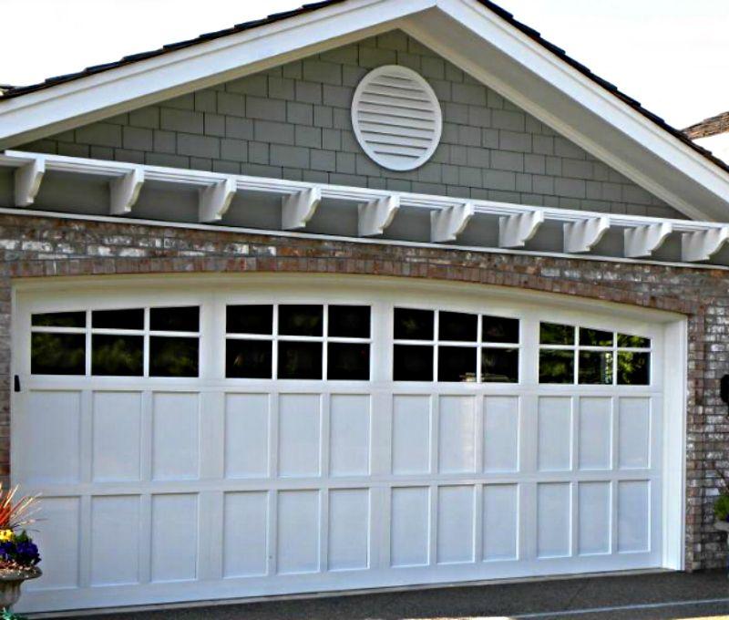 Paneled And Divided Light Garage Door Small House Mounted Pergola Above Garage Doors Garage Service Door Garage Door Styles