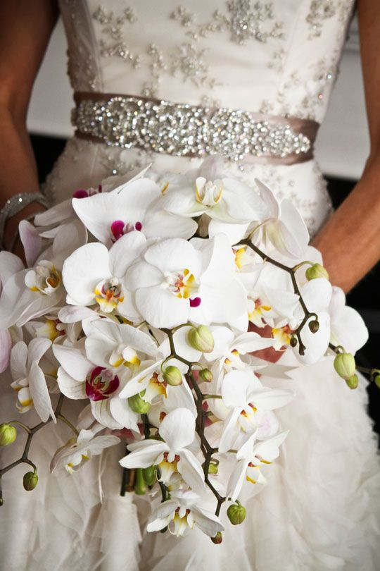 wow dress and unique bouquet - Misti Layne via CeremonyBlog.com...