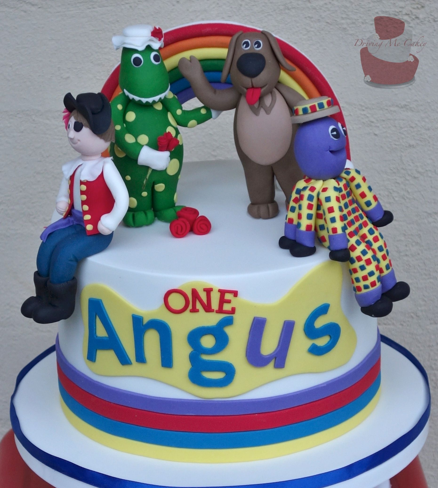 Wiggles Birthday cake with hand modelled Rainbow Wags the dog
