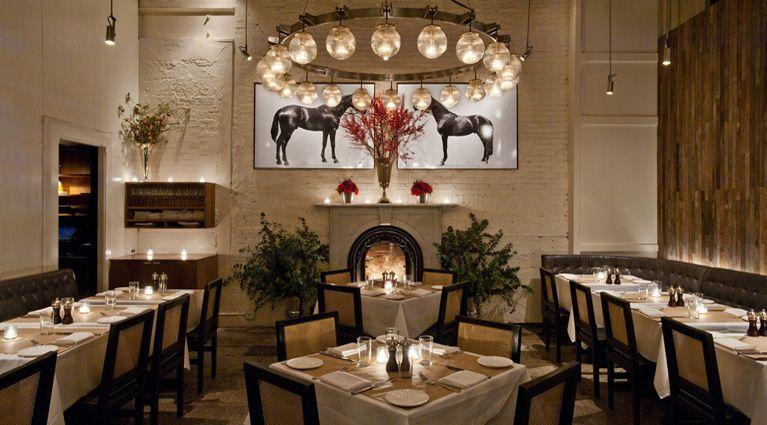 Equestrian themed Main Dining Room. Globe shades on pendants ...