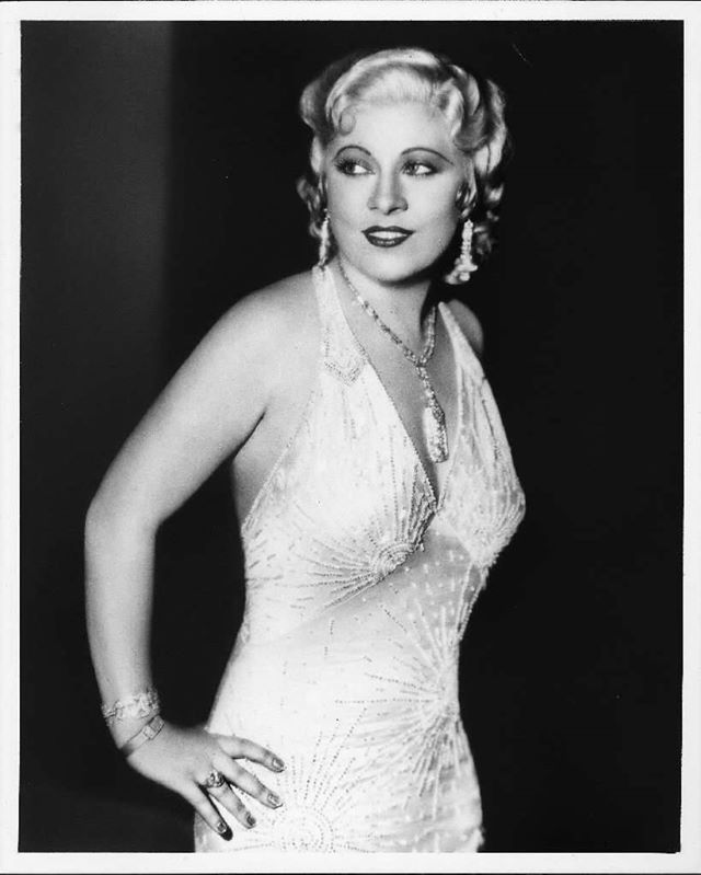 "Mae West opened on Broadway on this date in 1944 in her bawdy comedy ""Catherine Was Great."" A young Gene Barry was her co-star. The show lasted 191 performances. Photo of West appears in the Los Angeles Times book, ""High Exposure: Hollywood Lives– Found Photos from the Archives of the Los Angeles Times."""