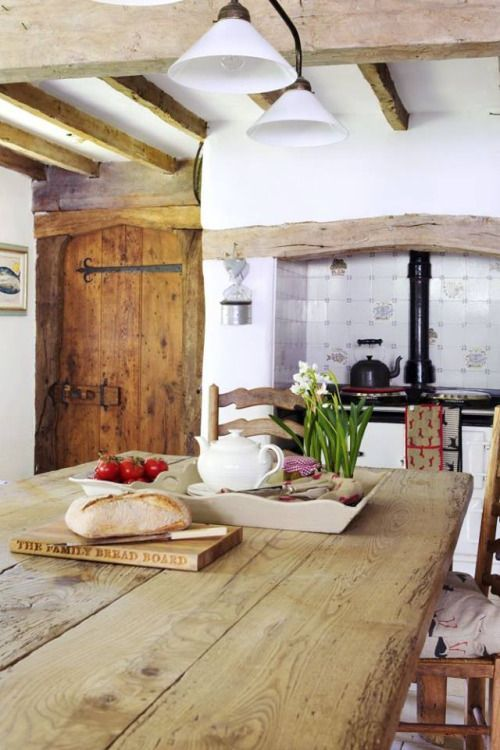 Beautiful English Cottage With The Wooden Beams And Farmhouse Table