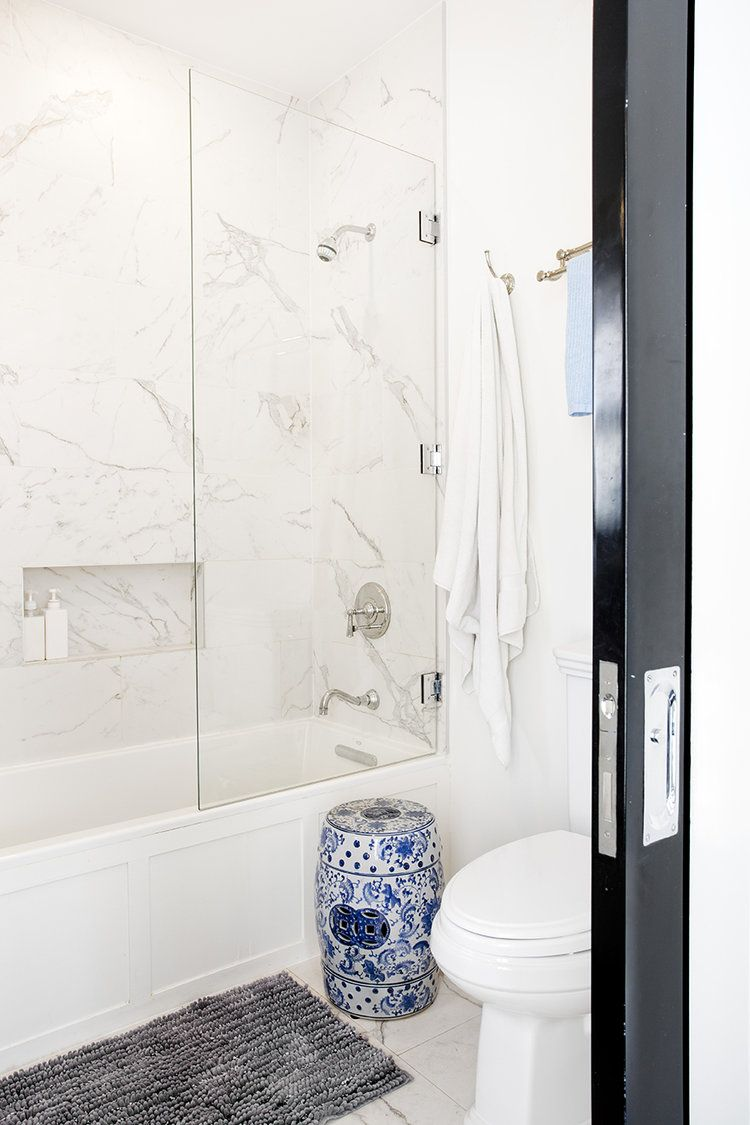 White marble bathroom design with with blue and white china stool ...