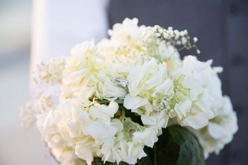 A classic shot with the rings nestled in the bouquet