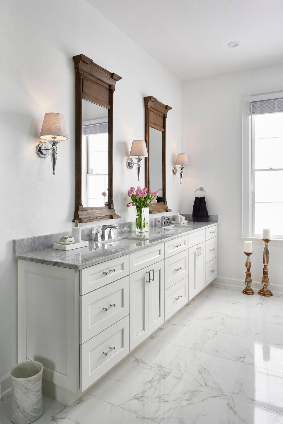 This Traditional White Master Bathroom Features Shaker Style Cabinetry With Carrara Marble Countertops Durable Porcelain Tile Floors Mimic The