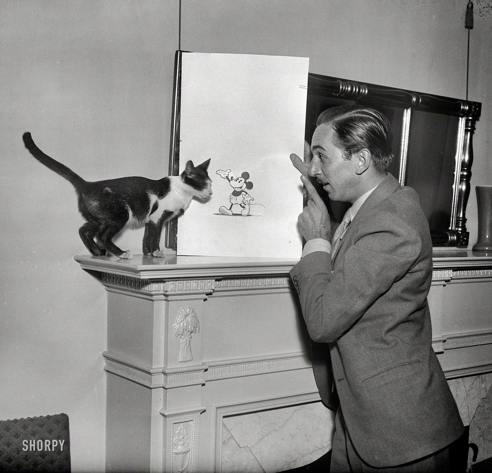 Walt Disney explaining Mickey Mouse to a cat in 1931. [1,600 × 1,537]